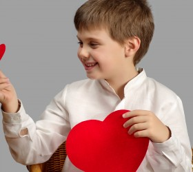 studio photography of a child with a heart of Valentine's day