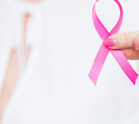girl holding pink breast cancer awareness ribbon